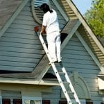 Painter Working at Roofline